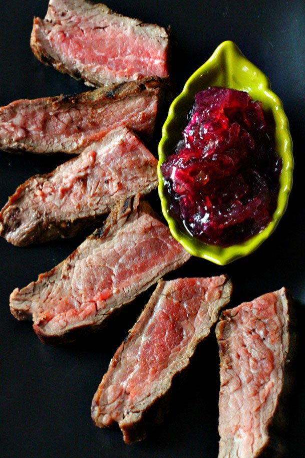 Easy pan seared flank steak with caramelized onion marmalade is a great recipe for a weeknight dinner.