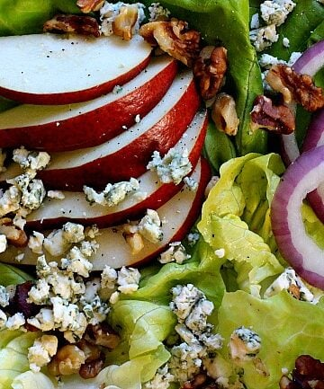 pear and walnut salad with cranberry vinaigrette, blue cheese and red onions
