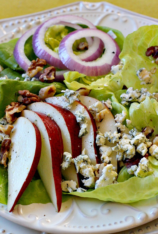 Pear and walnut salad with red onion, bibb lettuce, blue cheese and cranberry vinaigrette