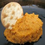 Sun dried tomato hummus without tahini. Flavored with mayonnaise, cayenne, and parmesan cheese, say hello to your new favorite hummus.