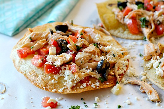 Homemade chicken tostada recipe with feta and olives. Easy Mexican Dish for a weeknight meal.