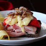 Ham and Manchego cheese sandwich with red bell peppers and caramelized onions
