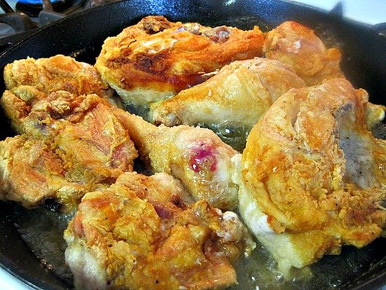 a pan of fried chicken pieces