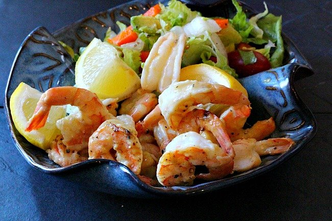 Glazed Dijon Honey Shrimp served in a blue ceramic bowl with a tossed salad.