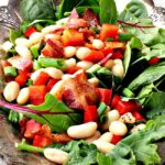 Easy bacon, white bean, spinach salad recipe. With maple vinaigrette, this is a popular and crowd pleasing salad recipe.