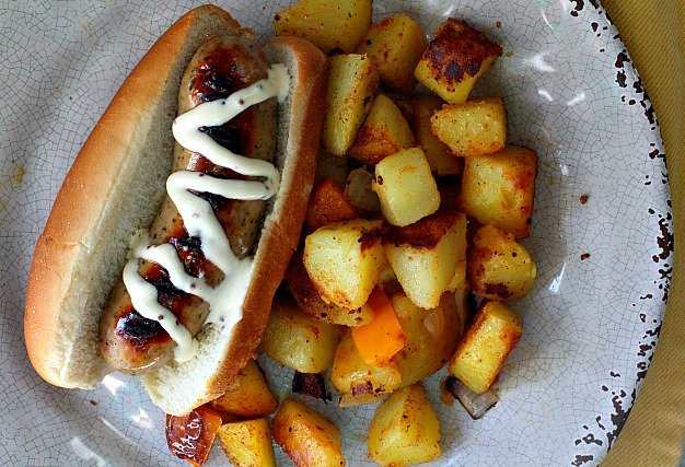 Ina Garten Grilled chicken apple sausage breakfast hotdogs with a mayo and mustard dressing and spicy country fried potatoes