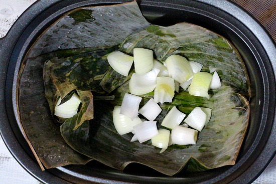 Pork Roast cooked in the slow cooker on banana leaves and onion. A great beginning to pulled pork sandwiiches.