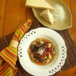 Easy Italian Soup Recipe that will knock your socks off. With red wine and pasta shells, this is a great dinner recipe.