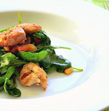 Grilled chicken salad with wilted spinach greens