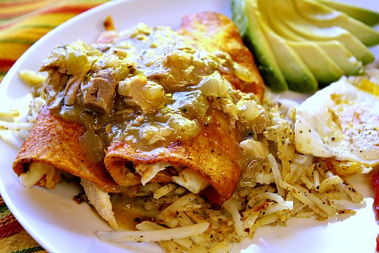 Breakfast Chicken Enchiladas with hash browns and eggs