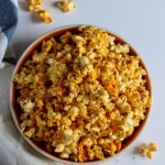 A bowl of homemade popcorn with spicy seasoning