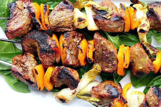 Sirloin steak beef kabobs with orange bell peppers and green onions
