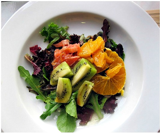 Citrus Salad. Colorful with pink grapefruit, orange and green kiwi, you just feel good eating it. The dressing is a cousin to a Catalina and a perfect match for the fruit and the peppery greens.