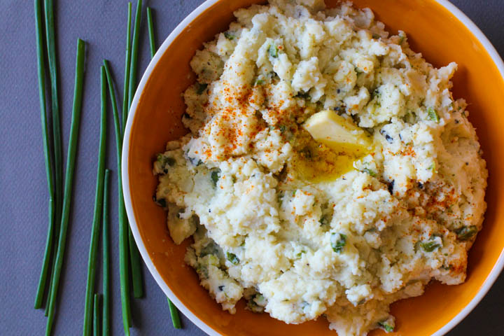 Orange bowl with mashed potatoes with poblanos and chives.