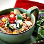 Sopa Ranchera Soup. Ranch Style Mexican Chicken Soup in a green Frankoma soup bowl