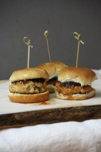 Thai Chicken Slider recipe. Easy and patties stay moist with shredded carrots and zucchini.
