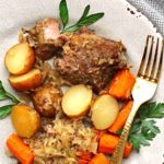 country style pork ribs cooked in slow cooker served with potatoes, carrots and sauerkraut