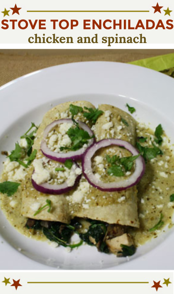 chicken spinach enchiladas topped with red onion rings and tomatillo cream sauce