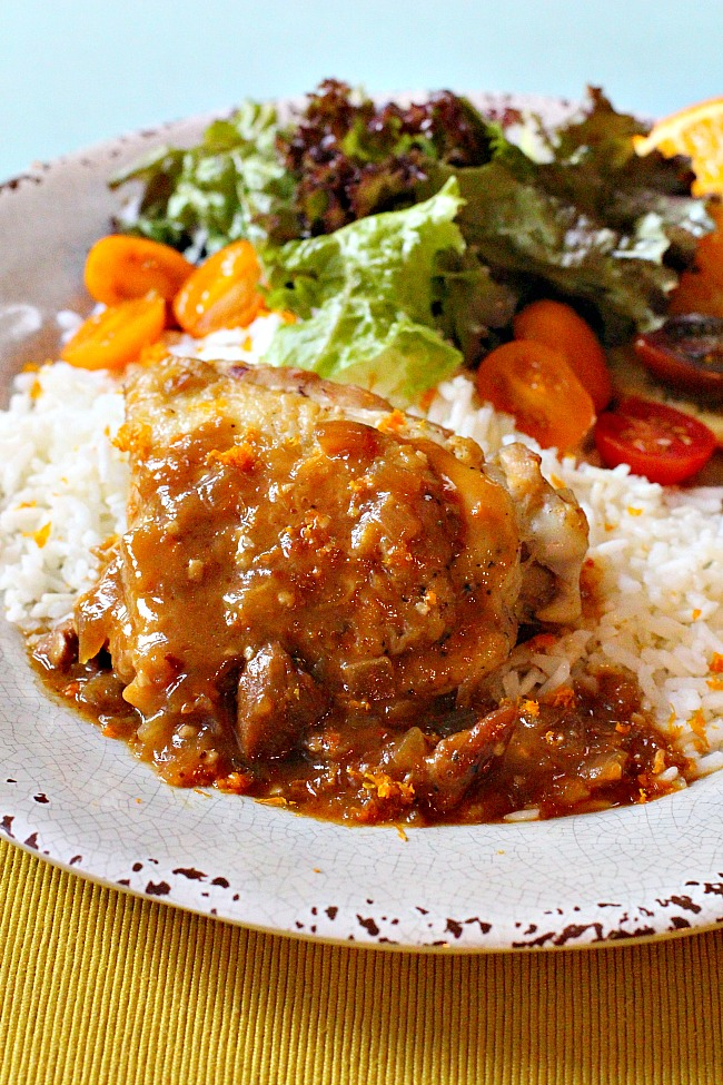 Tangering Chicken thighs in a tangerine star anise sauce served over rice with a tossed salad