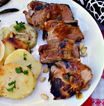Grilled Pork Tenderloin with Southwestern Zinfandel glaze with a side of sliced potatoes