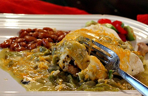 smothered breakfast burrito with green chile sauce