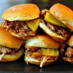 Dr. Pepper Pulled Pork Sliders. An easy and popular crockpot recipe, great for feeding a crowd.