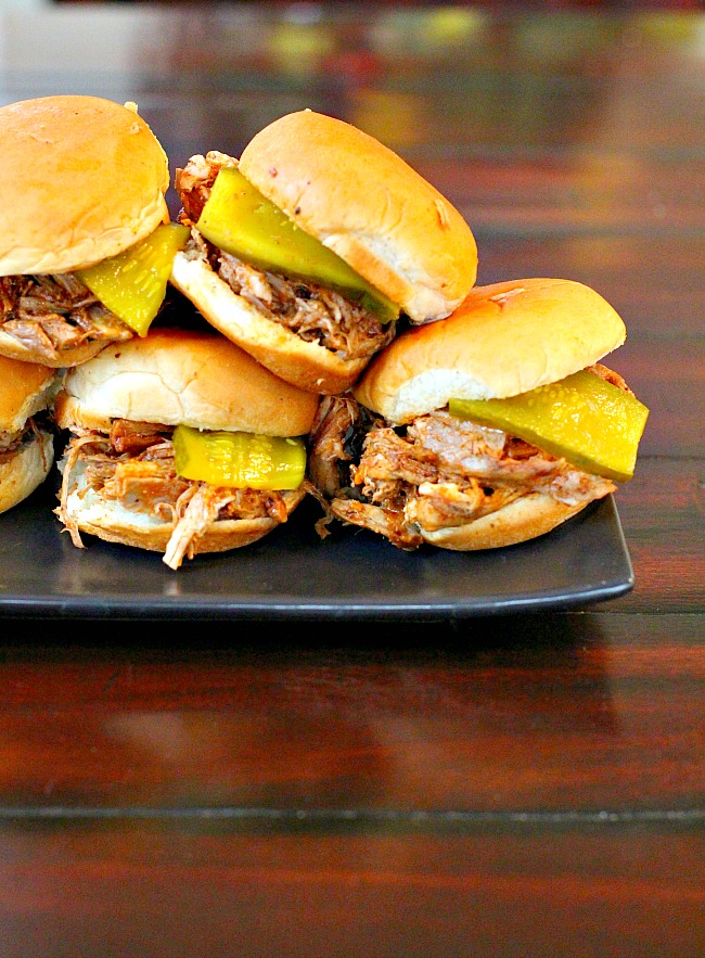 Easy Dr. Pepper pulled pork sandwiches. A crockpot recipe that easy and popular to feed a party crowd.