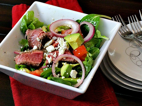 Chipotle Glazed Steak salad with avocado and pickled onions.
