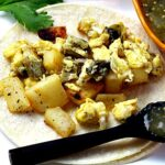 Mexican breakfast tacos with potatoes, scrambled eggs and Hatch green chili peppers