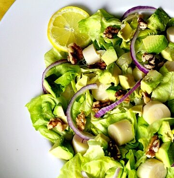 Hearts of Palm Salad with Avocado Butter lettuce and red onion.
