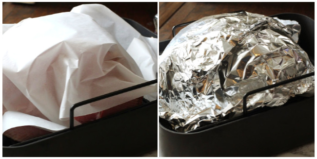 How to reheat a spiral ham in a roaster using parchment paper and aluminum foil