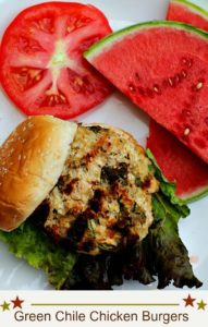 Hatch Green Chile Chicken Burgers with a slice of tomato and a slice of watermelon