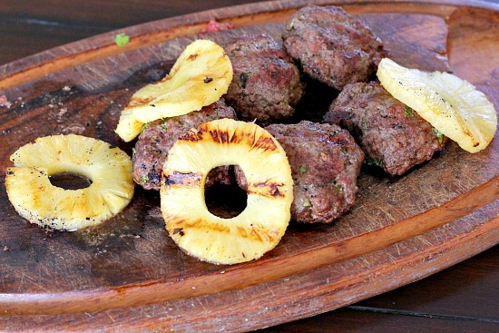 Beef sliders with Smoky in flavor and packed with goodness. Topped with a ring of pineapple and you've got a treat.