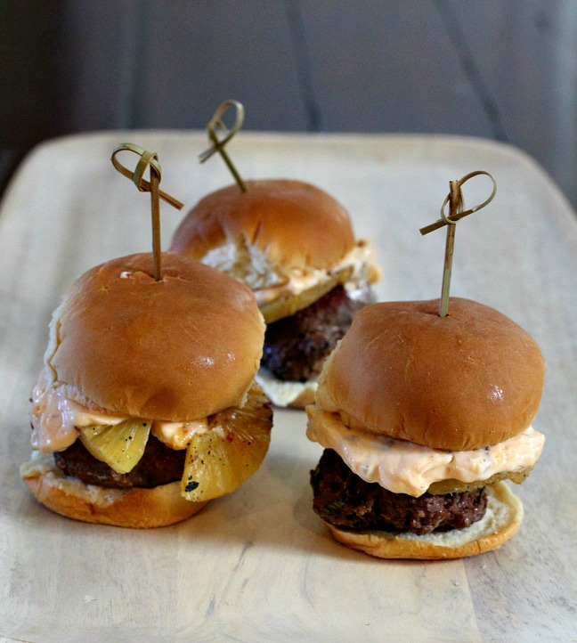 Southwestern Chipotle Sliders. A fabulous combination of flavors. Beef patties are flavored with chipotle and cilantro. And topped with a smear of chipotle mayo and grilled pineapple you got a smashing little slider. You've got to give these a try.