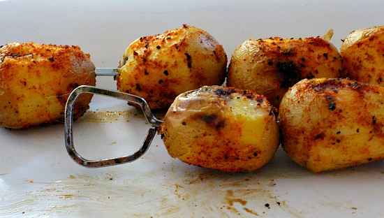 Grilled new potatoes with BBQ sauce, an idea for your next tailgating event.