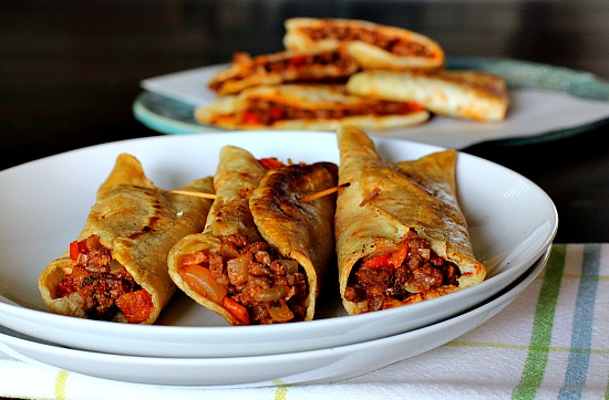 Fried Tacos. Seasoned ground beef tucked into corn and flour tortilla shells and pan fried. Serve with sour cream and salsa.