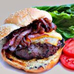 Grilled Rosemary Garlic Burgers with Wine Caramelized Onions and Hickory Smoked Gruyere.