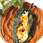 A poblano pepper filled with 2 cheeses, sweet corn and black beans in a bed of sweet, spicy, smoky pumpkin mole.