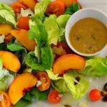 Butter leaf lettuce with fresh Colorado peaches, pistachios and peach pistachio vinaigrette.