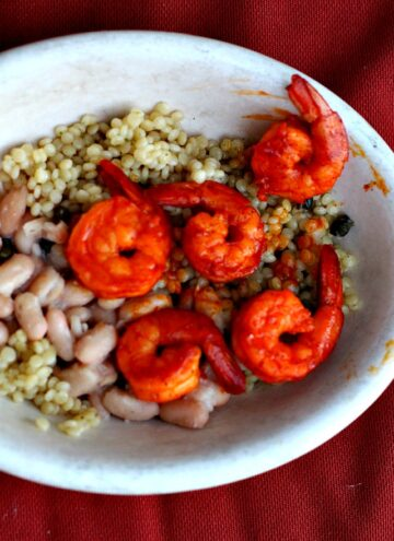 Easy Shrimp dinner. Spicy with Achiote and savory with white beans and couscous.