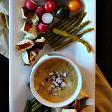 Cumin spiced gouda fondue. An easy fondue appetizer idea for your next dinner party.