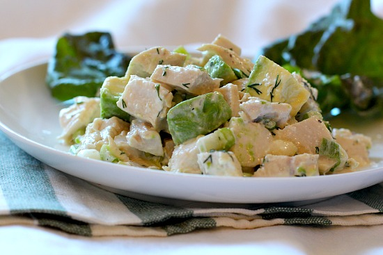 A recipe for avocado chicken salad mixed together with a creamy tangy dressing