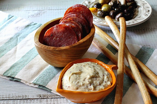 Baked Salami Appetizer with Grainy Mustard Sauce. A unique and exciting salami appetizer recipe.