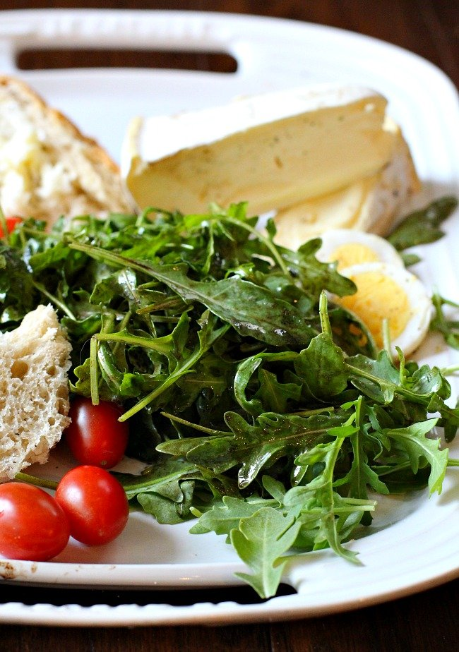 Arugula Salad with Truffle Oil and Balsamic Vinaigrette. Adding double cream cheese, bread and sliced hard boiled eggs makes this a light Summer meal.