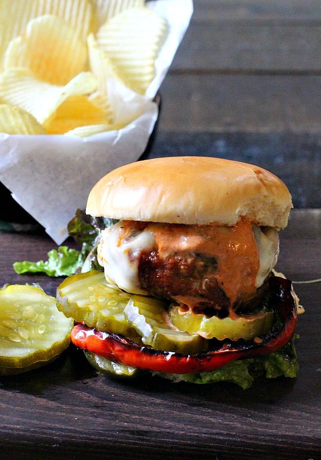 Buffalo Burger with Creamy Barbeque sauce on a bun with pickles.
