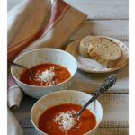 Creamy tomato soup with fire roasted tomatoes topped with grated cheese.