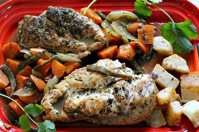 Close up of Chicken in Tangy Escabeche with carrots, jalapenos on a red Le Creuset serving platter