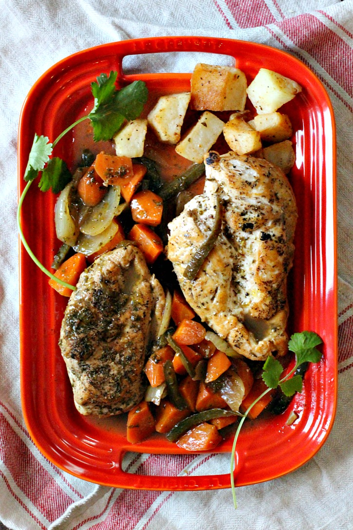 Chicken in Tangy escabeche with roasted potatoes on a red Le Creuset Platter