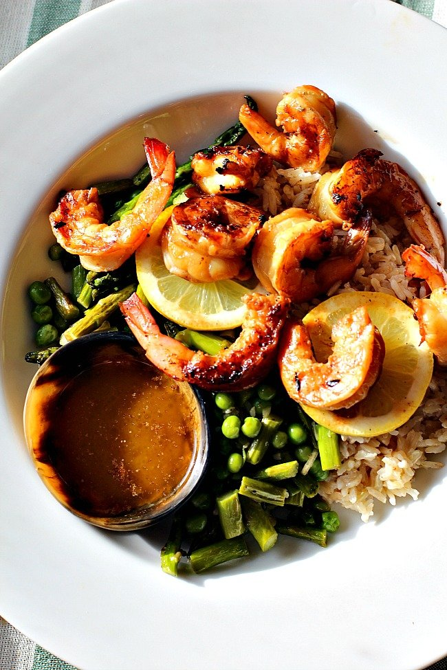 The best grilled shrimp recipe with rice, asparagus and butter dipping sauce.