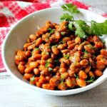 Instant Pot Pinto Beans with Chorizo. garnished with cilantro.